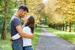 Young Couple Walking in autumn park Royalty Free Stock Photo