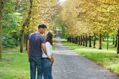 Young Couple Walking in autumn park. Romentic Beautiful young couple walking in autumn park stock images