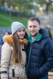 Young Couple Walking Through Autumn Park Royalty Free Stock Photos