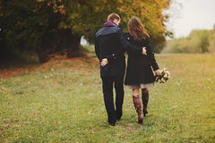 Young couple walking away Stock Images