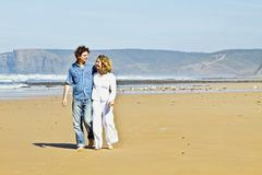 Young couple walking at the beach Royalty Free Stock Image