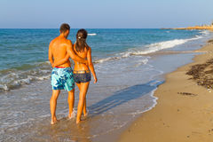 Young couple walking on the beach Royalty Free Stock Image