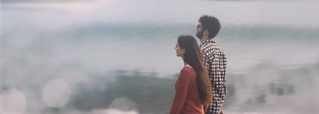 Young couple walking on the beach royalty free stock photo