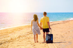 Young couple walking on the beach Stock Images