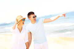Young couple walking at the beach Stock Images