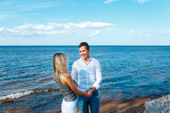 Young couple walking on the beach. Romantic couple in love Stock Photos