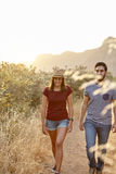 Young couple walking in bright sunlight Stock Photo