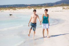 Young Couple Walking on Caribbean Beach Royalty Free Stock Images