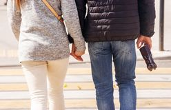Young couple walking in the city stock photography