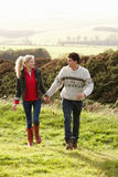 Young couple walking in countryside royalty free stock image