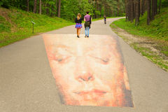 Young couple walking on the 3D painting Royalty Free Stock Images