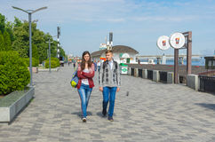 Young couple walking on the Dnepr river embankment. DNEPR, UKRAINE - MAY 21, 2016:Young couple walking on the Dnepr river embankment at May 21, 2016 in Dnepr royalty free stock photo