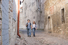 Young couple walking down a medieval street Royalty Free Stock Images