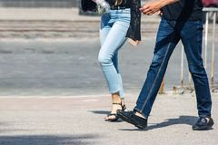Young couple walking down the street stock images