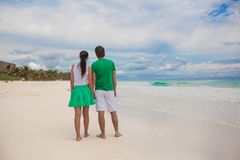 Young couple walking on exotic beach in sunny day Stock Images