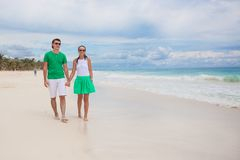 Young couple walking on exotic beach in sunny day Royalty Free Stock Photo