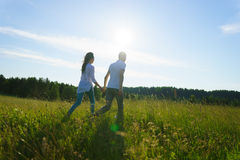 Young couple walking Royalty Free Stock Images