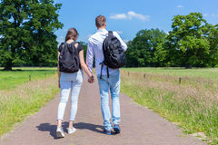 Young couple walking hand in hand in nature Royalty Free Stock Images