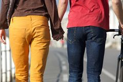 Young couple walking and holding hands Royalty Free Stock Images