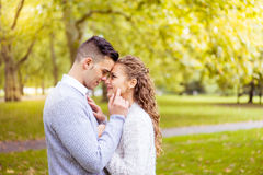Young couple walking, Hyde Park, London: sunset colour tone Royalty Free Stock Image