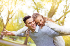 Young couple walking, Hyde Park, London: sunset colour tone Royalty Free Stock Photos