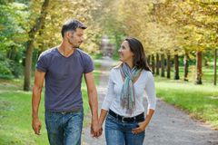 Young Couple Walking In Autumn Park Royalty Free Stock Images