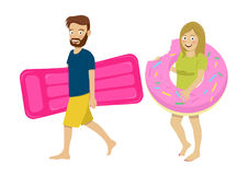Young couple walking with inflatable mattress and sprinkled donut float. Isolated over white background Stock Images