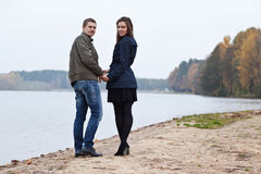 Young couple walking on lake Stock Images
