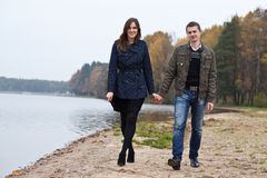 Young couple walking on lake Royalty Free Stock Images