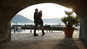 Young couple walking by the lake, flirting stock video footage