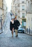 Young couple walking on a street of Montmartre Stock Photos