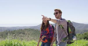 Young couple walking in mountains stock video