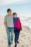 Young couple walking near the sea Stock Photography