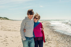 Young couple walking near the sea Royalty Free Stock Image