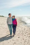 Young couple walking near the sea Stock Image