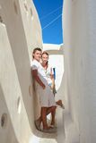 Young couple walking in old greek village on Stock Images