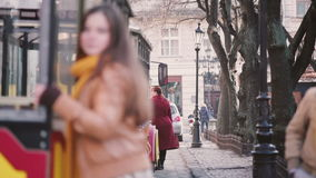 Young couple walking in the old part of city near tram stock footage