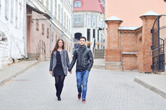 Young couple walking in an old town Royalty Free Stock Images