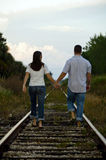 Young Couple Walking On Rail Tracks Stock Photography