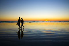 Young Couple Walking On Romantic Beach At Sunset Royalty Free Stock Photos