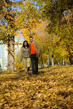 Young couple walking in the park Royalty Free Stock Photography