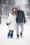 Young couple walking in a park Stock Image