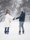 Young couple walking in a park Stock Photos