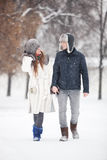 Young couple walking in a park Royalty Free Stock Photo