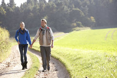 Young couple walking in park Stock Images