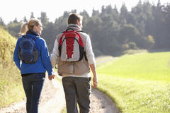 Young couple walking in park Royalty Free Stock Photo