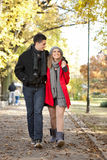 Young couple walking in park Royalty Free Stock Photography