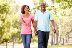 Young couple walking in park stock photos