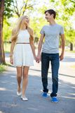 Young couple walking in a park Stock Images