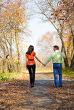 Young couple walking in the park stock photography